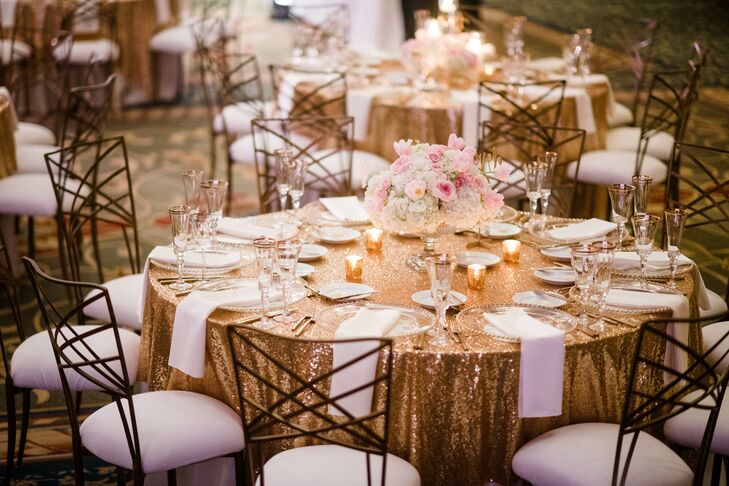 Chameleon chairs, gold sequin linens, warm candles and soft blooms combined to create a romantic and glamorous ambiance for the New Year's Eve reception at Renaissance Cleveland Hotel in Cleveland, Ohio.