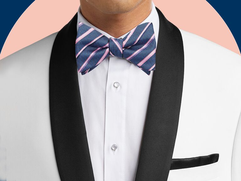 man in white suit jacket, white shirt and colorful bow tie