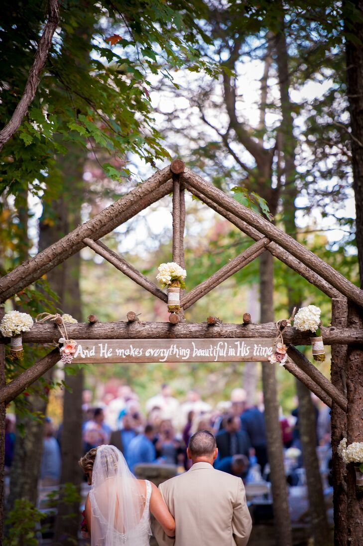 "For the outdoor ceremony, Megan and John set up a rustic wooden frame entryway so that Megan could make a grand entrance. The arch featured a sign that read, ""And He makes everything beautiful in His time."""