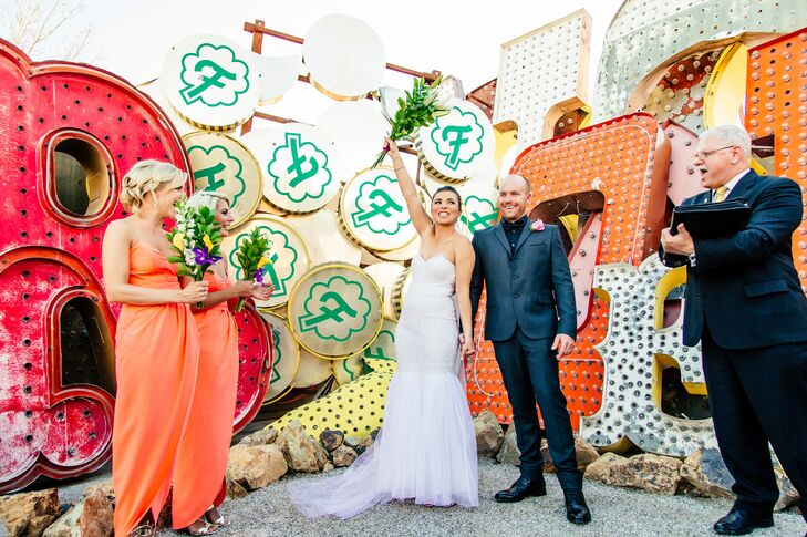 """The couple discovered The Neon Museum online, and knew it suited the vibe of their wedding: It was private, just for them and their small group of guests, yet it was vibrant, colorful and exciting. """"We fell in love with all the bright colors and beautiful discarded signs,"""" Stacey says."""