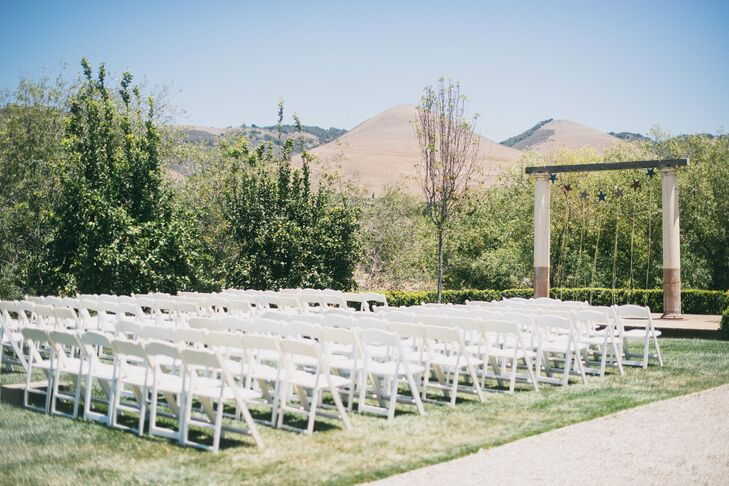 The wedding ceremony was held next to the lemon orchards and simply decorated with wildflower arrangements atop wooden boxes.