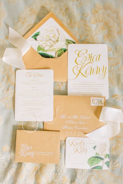 "Designers Oak and Orchid custom-designed all the stationery, complete with whimsical script lettering, a vintage-inspired floral motif and playful floral ""love"" stamps. They hand-lettered each of the gold envelopes and gave the invitations a refined, formal feel."