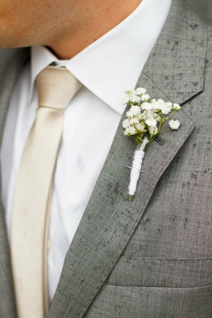 Blake paired his neutral satin tie with a boutonniere of baby's breath tied with white yarn.