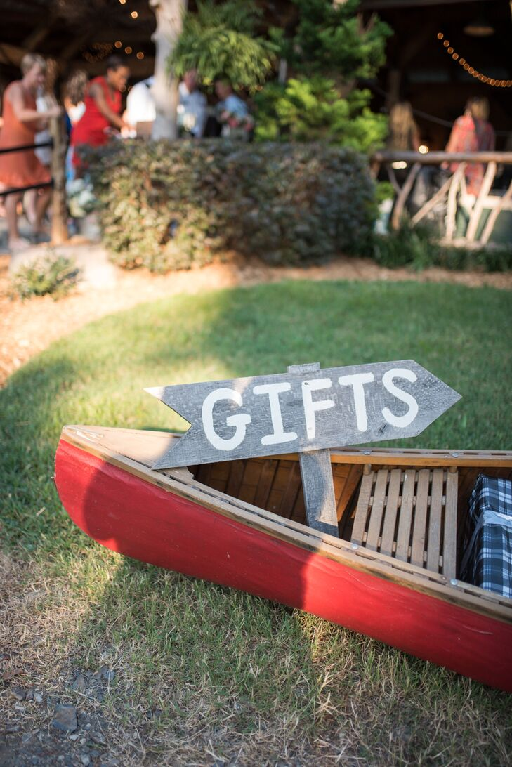 In lieu of  a gift table, presents were loaded up into a canoe for Morgan and Park.