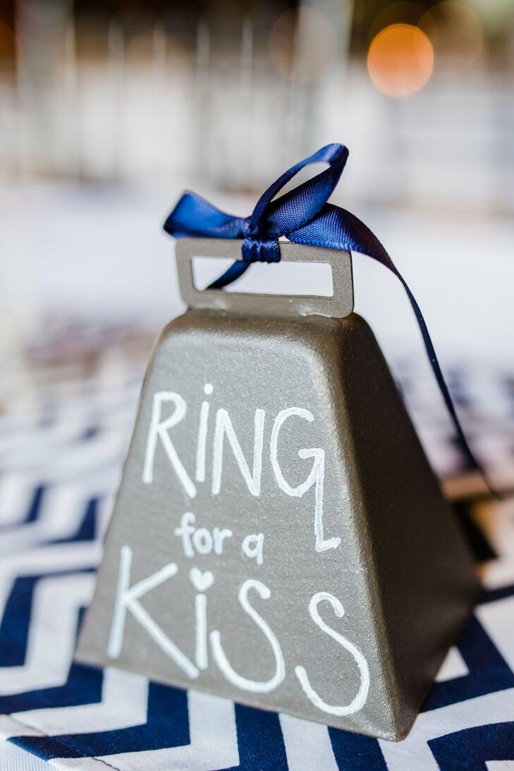 "As a nod to their dairy barn venue, Blair and Bryan had a cow bell that read ""ring for a kiss"" available for friends and family to ring."