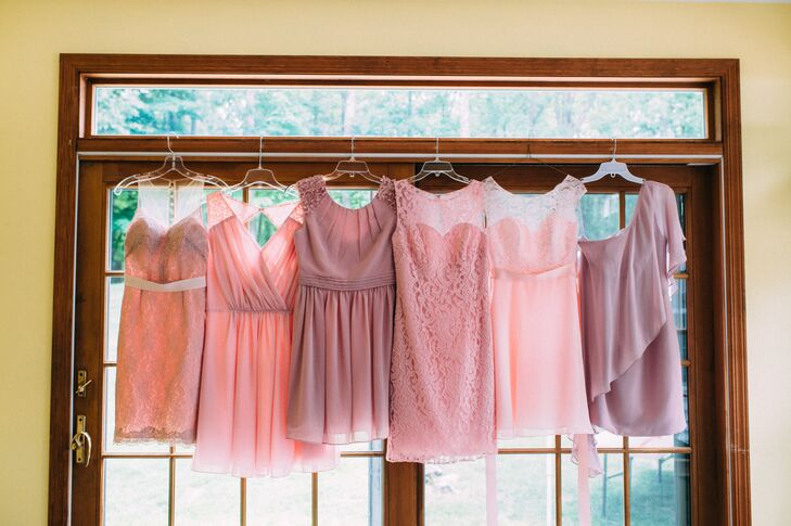 """Each bridesmaid rocked the couple's romantic pink and mauve color scheme with her own personal twist. The only instructions Kim gave them were to think vintage and shades of pink. """"It was important that they feel comfortable in what they had to wear, shoes included,"""" Kim says. """"So I said to have at it and just show me before you buy."""" Each dress had added lace, rosettes, ruching or a cascading detail to meet the day's whimsical inspiration."""