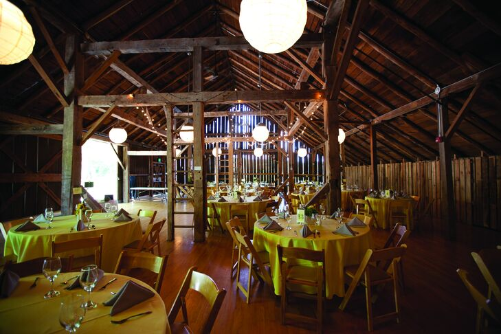 The rustic barn was dressed up with yellow-linen-draped tables and gray napkins.