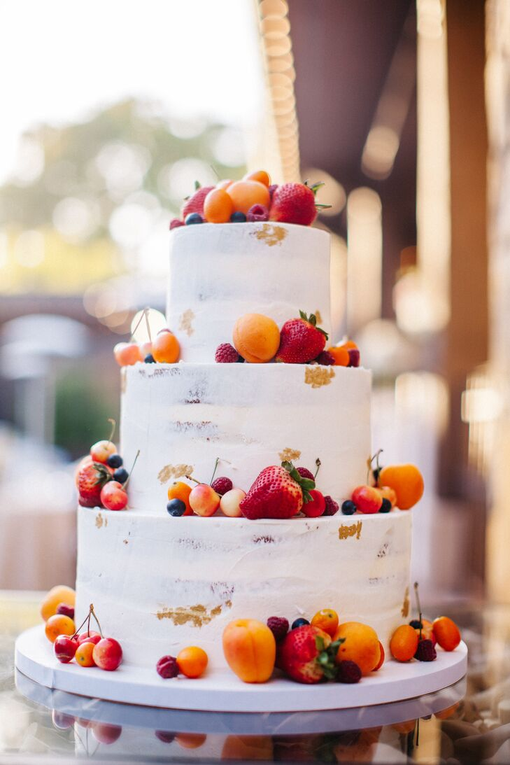 Fleur de Lisa bakery in Santa Rosa, California, created a lush three-layer cake topped with apricots, cherries and strawberries, a perfect fit for the wedding's verdant natural setting in Napa Valley.