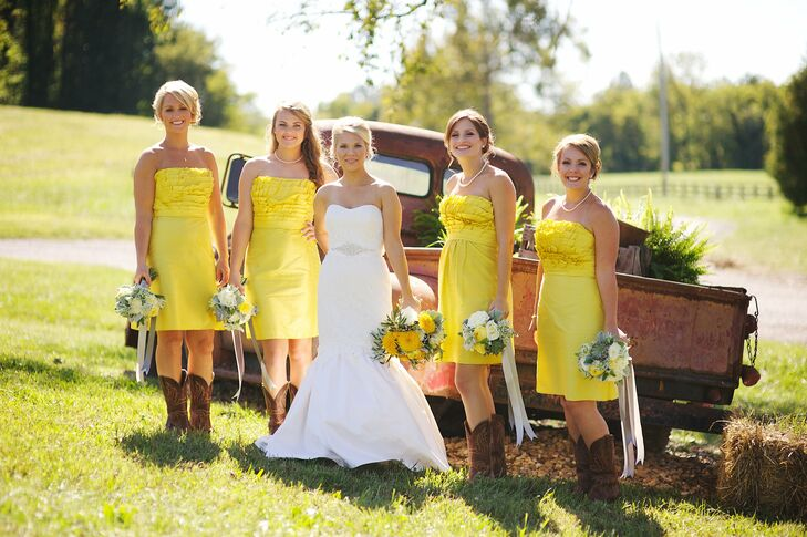 Jenni's bridesmaids wore short yellow Watters gowns with a ruffled bodice. The girls' Arait cowgirl boots from Boot Barn added some southern charm to their wedding day outfits.