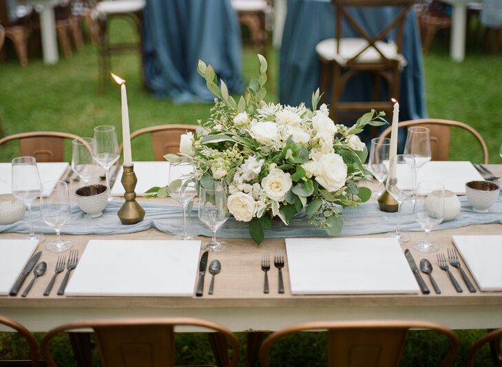 Chic White and Green Centerpiece on Light Blue Table Runner