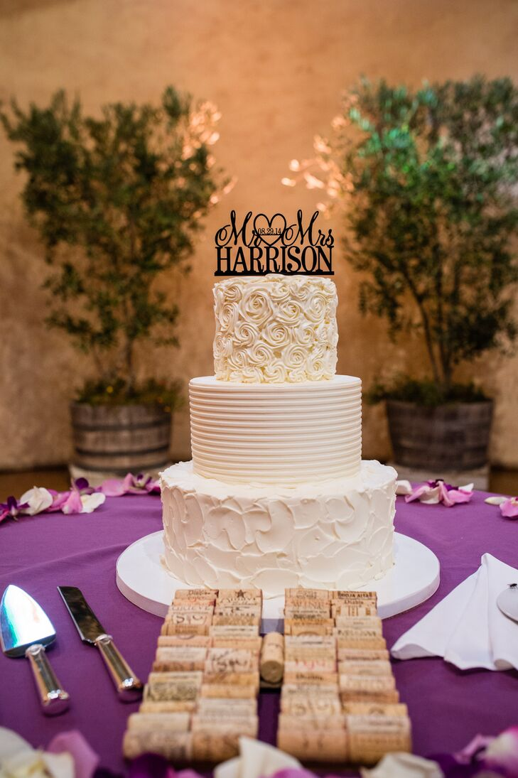 """The three-tier ivory wedding cake had a different textured pattern on each layer, with different fillings. """"We chose this combination so each layer had its own style and flavor, which made for great variety for all our guests,"""" Christine says."""