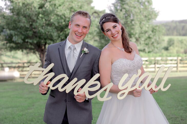 """A totally Texas twist on a traditional thank-you,  Anna and Adler posed with these champagne-colored words, """"Thanks, y'all,"""" to show their guests appreciation for celebrating with them."""