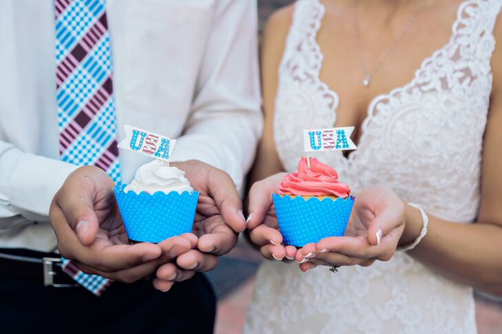 "In addition to having two cakes, Samantha and Chris took their patriotic theme one step further with red, white and blue cupcakes adorned with ""USA"" toppers."