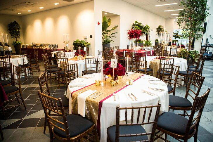 Round Reception Tables with Red and Gold Décor and Chiavari Chairs