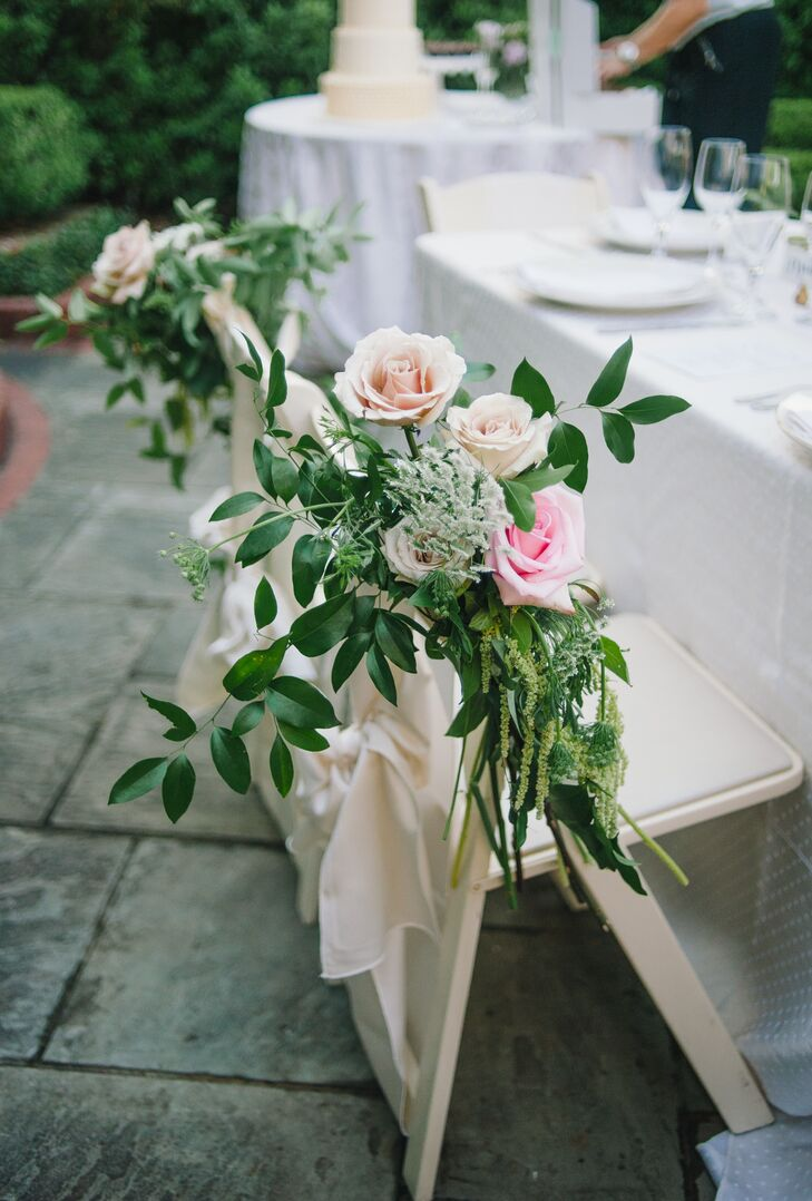 """My favorite thing about the garden look is that you can get the polished, refined look but still feel like you're just hanging out with good friends,"" Monica says. This sentiment was even carried into their reception seating. Monica and Andy had natural accents added to their reception chairs with these lush arrangements of blush, ivory and pink roses, amaranthus and eucalyptus from Something Special in Flowers. Each one brought in their theme but without being too expensive, so friends and family members had plenty of room to come and say ""hi."""