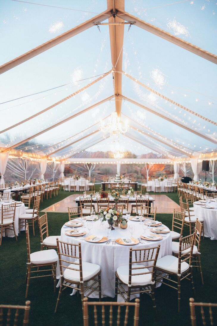Chandeliers and twinkle lights add a touch of glamour to the tent.