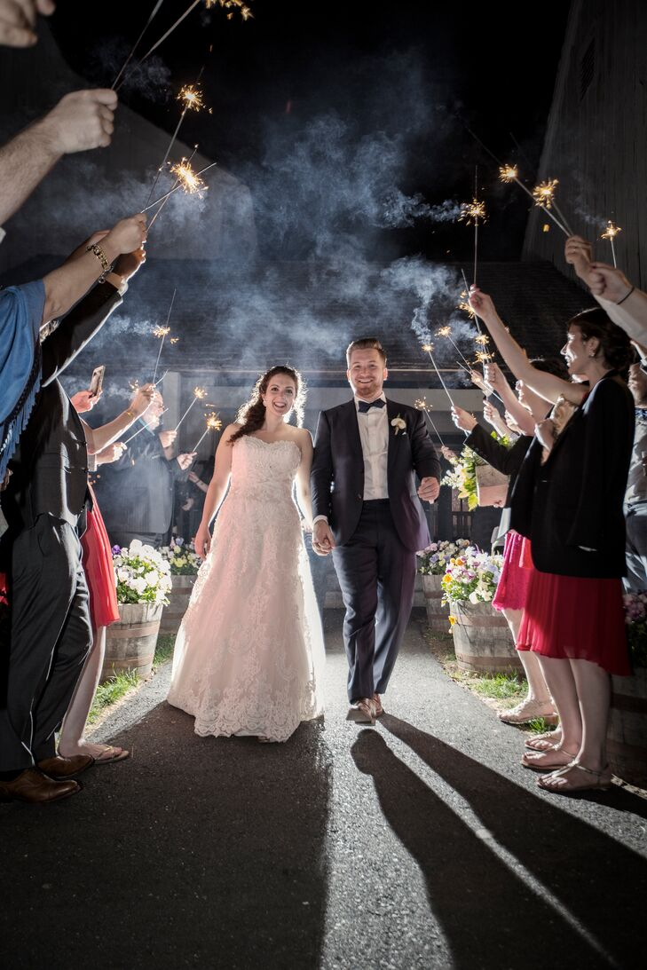 "At the end of the evening, Tara and Graeme's family and friends sent them off in style, forming a tunnel of brightly lit sparklers. Wanting to keep the party going, the couple invited their guests to join them for an after-party at the Griswold Inn in Essex, Connecticut, where a live band was performing. ""They sang 'Going to the Chapel' when we walked in,"" Tara says."