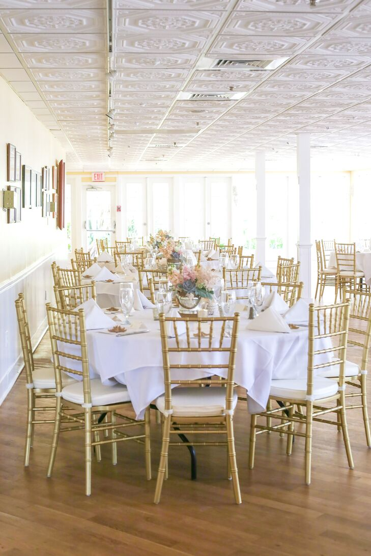 Wanting to accent the 'Tween Waters Inn Island Resort's bright buildings with a softer palette, Lindsey and George decorated their reception with gold chiavari chairs, white linens and lush low centerpieces. Each arrangement had a soft display of blush, white and green flowers.