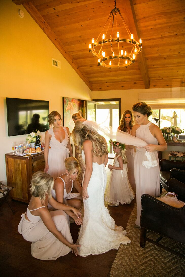 The ladies all got ready together, helping Lindsey get into her dress and veil. They had their hair and makeup done by the bride's hairdresser and makeup artist.