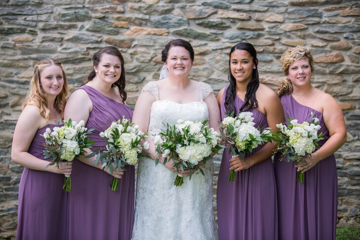 The bridesmaids wore purple chiffon floor-length dresses, which were paired with white and green bouquets.