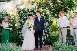 Casual Backyard Ceremony with Flower Arch