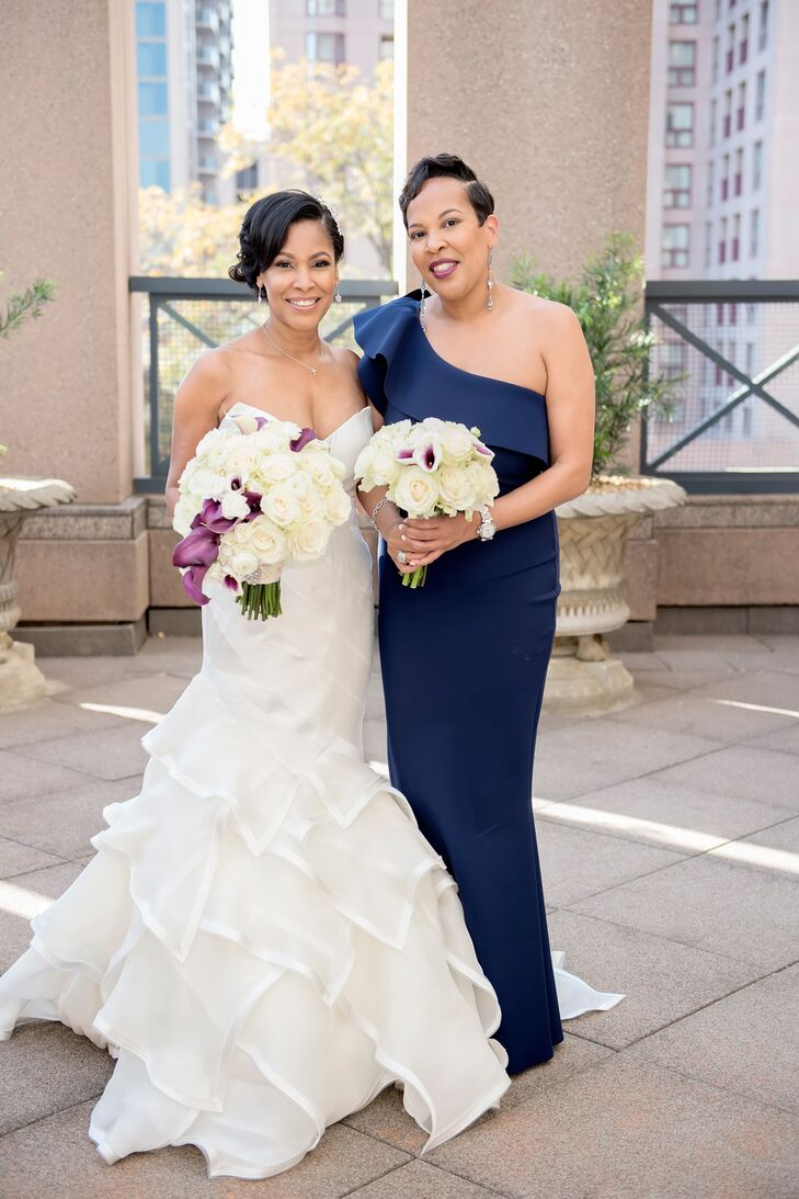 Angela's sister was her maid of honor, and she donned a navy one-shoulder gown by La Petite Robe di Chiara Boni. She paired it with ombre navy Jimmy Choos.