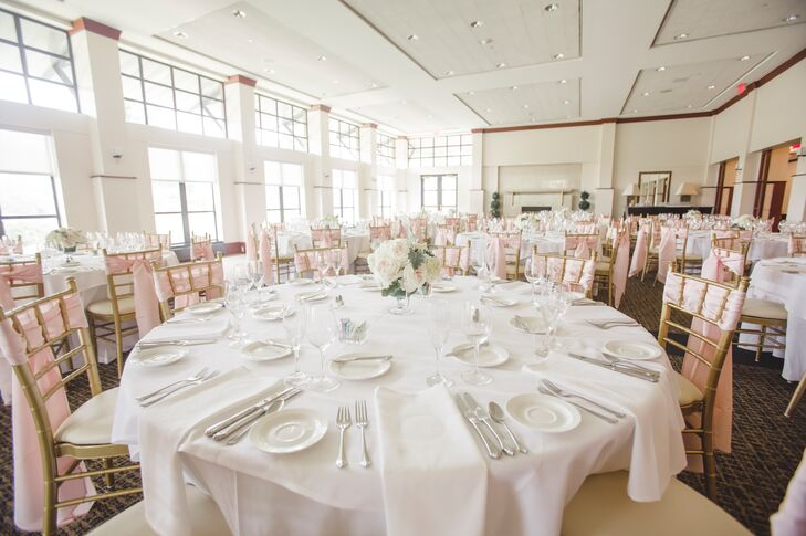 White linens, gold chiavari chairs and blush accents kept the light-filled reception room feeling airy and elegant.