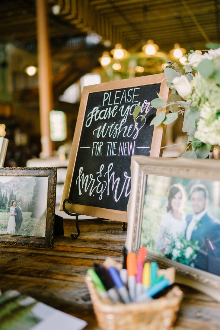 Handcrafted chalkboard signs encouraged guests to leave notes and well-wishes in the couple's guest book.