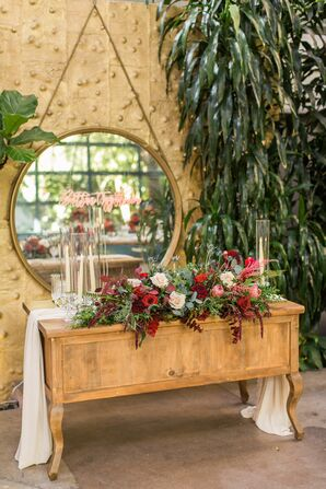 Wood Table with Candles and Red Flowers