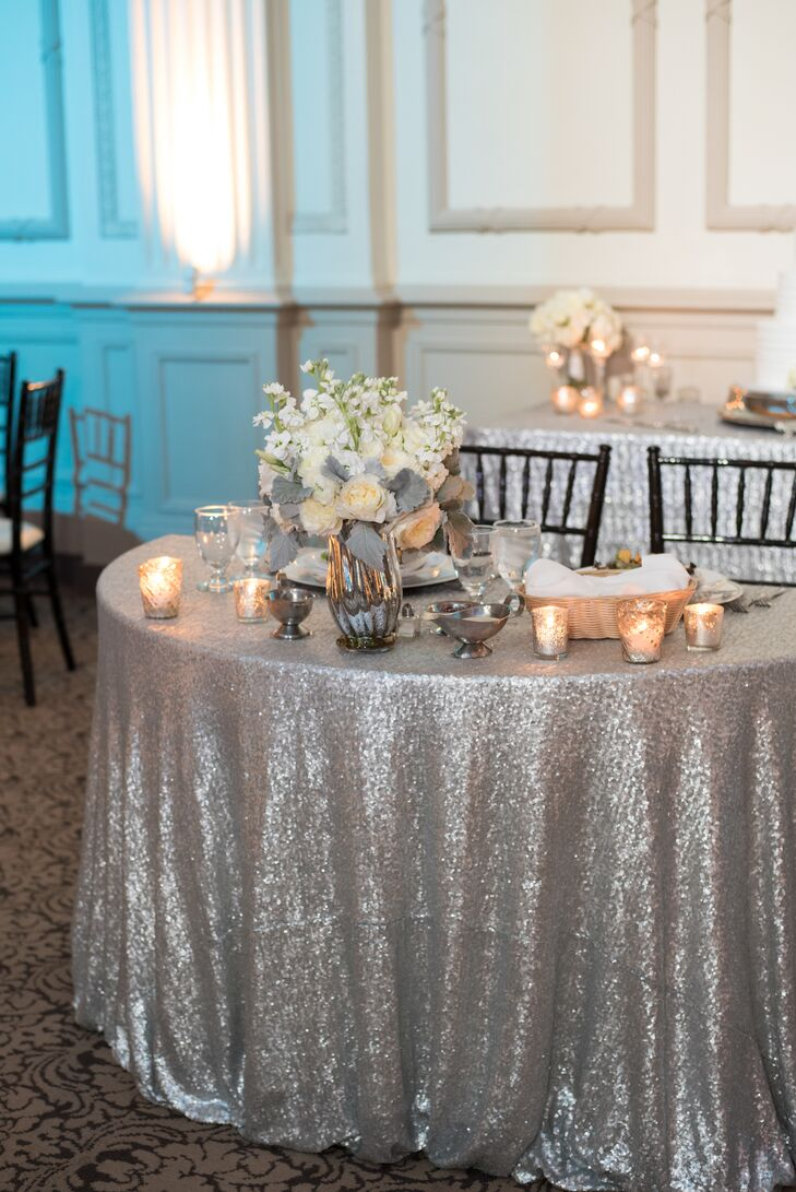 Sweetheart Table with Silver Linens and Low Centerpieces