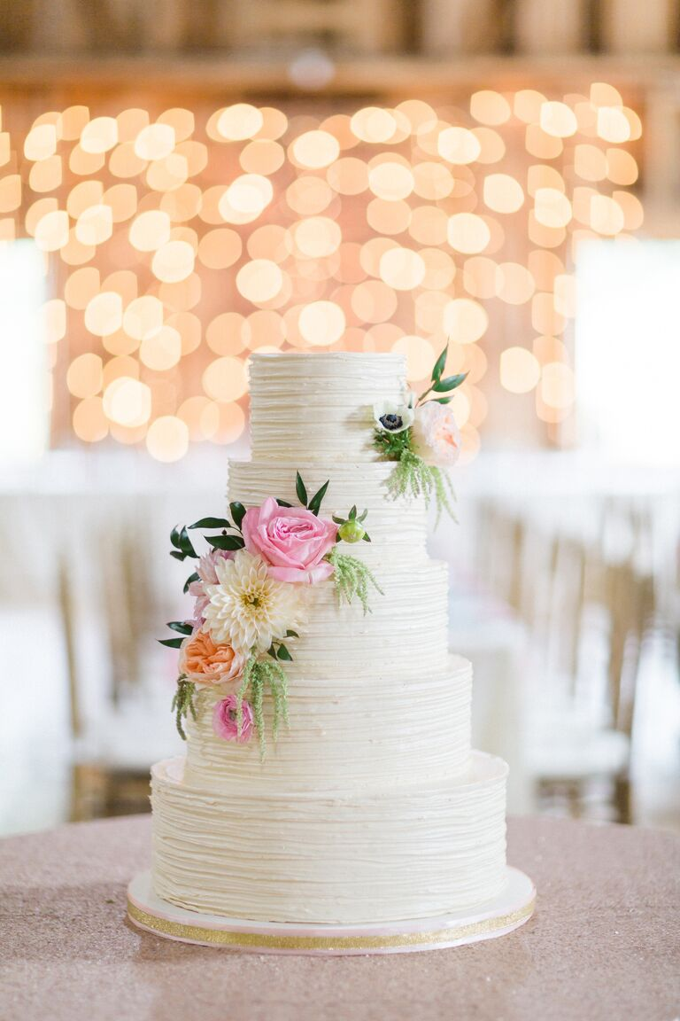 White Wedding Cake With Textured Ercream And Fresh Flowers