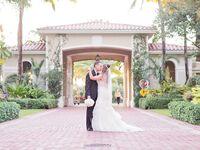 Newlyweds under archway in Florida