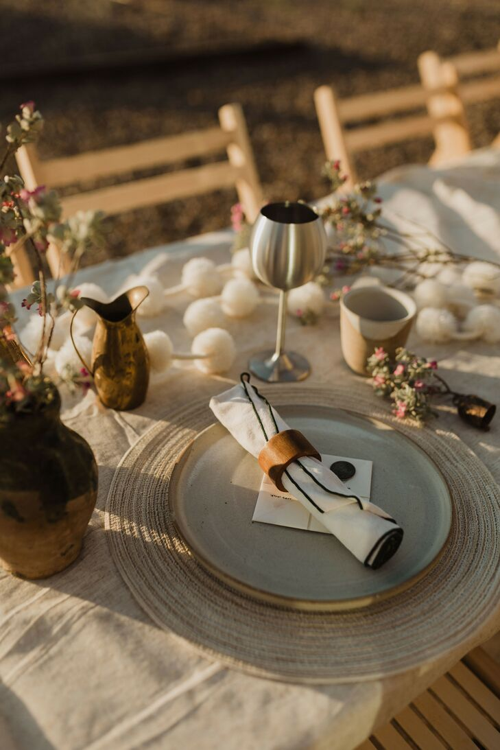 Bohemian Place Setting with Wicker Placemat and Mismatched Glassware