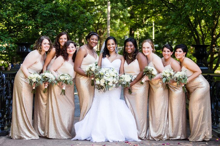 The bridesmaids found their gold gowns at the same bridal boutique that had been so successful for Whitley. The groomsmen wore black tuxes, white shirts and slim ties from Men's Wearhouse. The groom wore a black bow tie to stand out from the groomsmen.