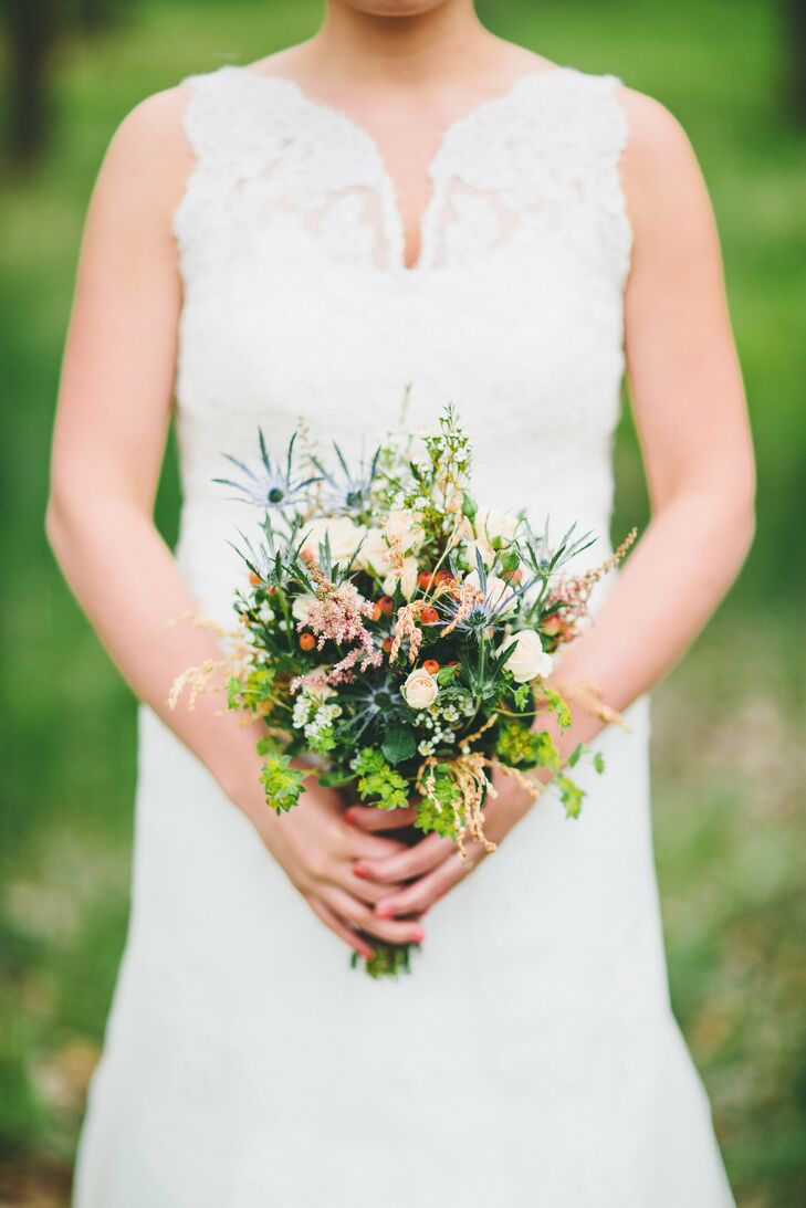 Rachel carried a rustic posy of thistle and assorted wildflowers.