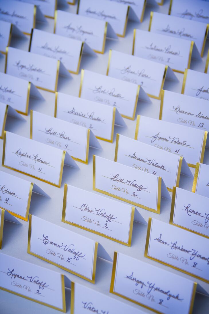 Once guests arrived for the reception at Catta Verdera Country Club in Lincoln, California, they found their seats by locating their simple white escort card bordered with gold.