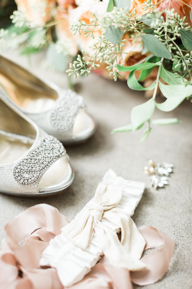 Intricate beading decorated the toe of Bonnie's peep-toe ivory satin heels.