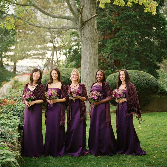 Each bridesmaid wore an aubergine floor-length dress in the style of her choice. As their gift, Elizabeth had custom necklaces created from crystals and black pearls.