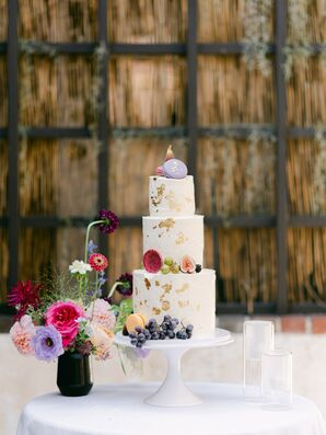Three-Tier Wedding Cake Accented With Jewel-Tone Flowers