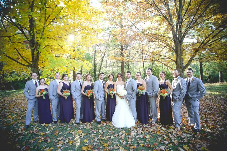 The bridesmaids wore floor-length purple Bill Levkoff dresses in whatever style they wanted. The groomsmen wore gray Savvi Formalwear suits with purple ties to match the bridesmaids.