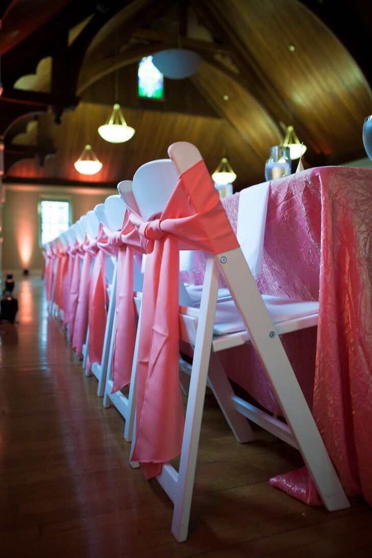 To bring their reception space to life, Mallory and Michael added bright pops of color wherever possible. Panels of pink fabric were tied into bows on each chair, matching the brightly-hued table linens.