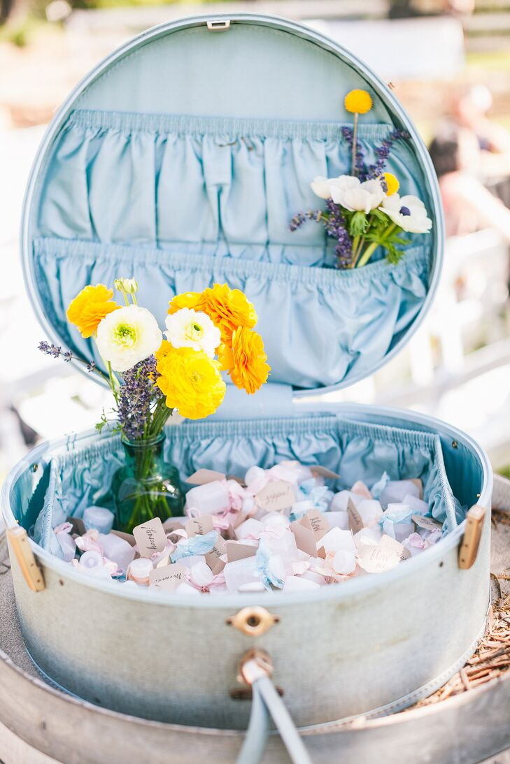 At the outdoor ceremony, bottles filled with bubbles were given to guests to blow when the couple walked back up the aisle during their recessional.