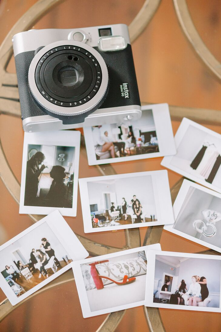 """The newlyweds included a Polaroid photo booth into their reception setup so friends and family could capture memories of their special day. """"Our friends could keep the photos they took, or they had the option of adding the photo to our guest book,"""" Jennifer says. Alongside their photos in the guest book, friends and family left messages for the couple."""