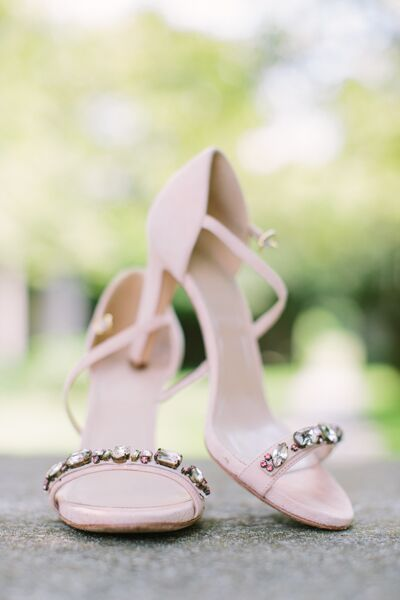 Before she'd even found her wedding dress, Erica spotted a pair of shimmery heels at J.Crew and knew she had to have them. The limited-edition kicks were a pale pink color—perfect for the wedding's palette of peach, blush and gold hues— and featured beaded embellishments along the toe.
