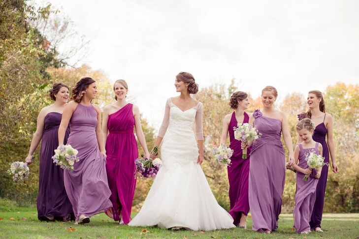 The bridesmaids wore three different shades of purple: sangria (how appropriate for a vineyard wedding!), plum, and wisteria.