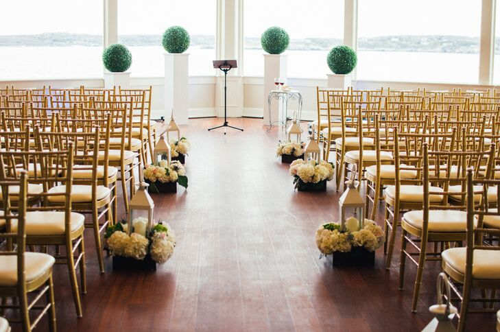 """Yecelin and Adrian had hoped to host their wedding outdoors, the New England weather had different ideas. Luckily, the Ocean Cliff Hotel offered plenty of indoor spaces with spectacular views, providing the couple with the best of both worlds—a warm, dry spot to say their """"I dos"""" with all the iconic charm that Newport, Rhode Island, had to offer."""