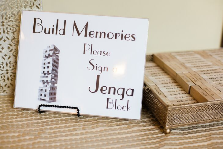 A fun alternative to the traditional guest book, the couple asked their guests to sign Jenga blocks that were laser cut with their wedding date.