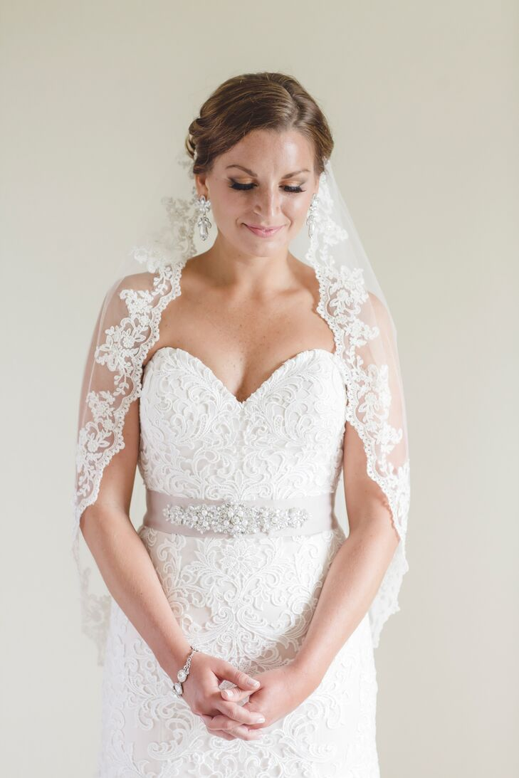 The sweetheart strapless lace gown was accessorized with a blush beaded sash, vintage-inspired jewelry and a romantic matilla-style veil.