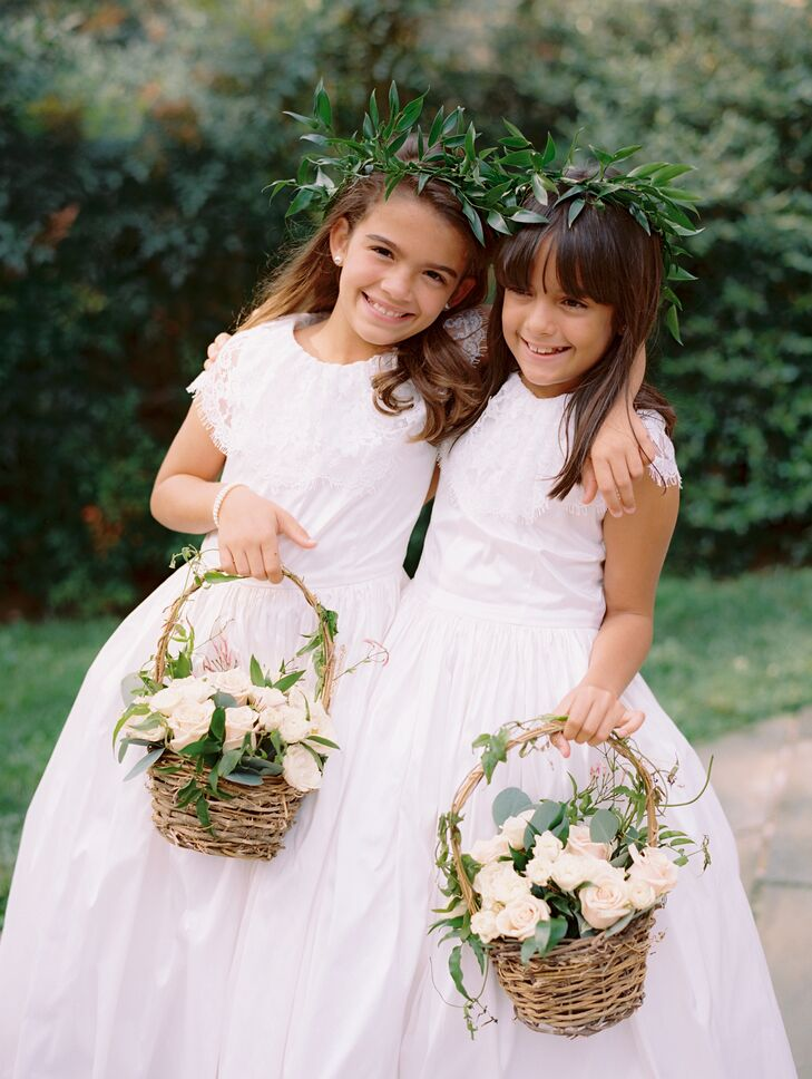 The flower girl custom dresses were inspired by the iconic designs of the late Oscar de la Renta (another Dominican) and were handmade in the Dominican Republic by the couple's tailor.