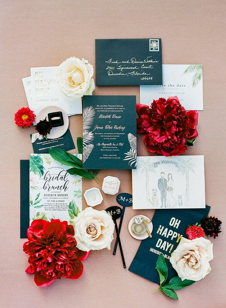 Glam black-and-white wedding invitation suite with tropical leaf illustrations